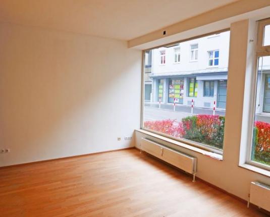 Verkaufsfläche mit Wohnmöglichkeit in Zentrallage